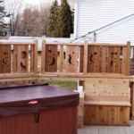 wood privacy screening around hot tub