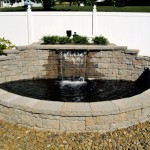 Erney Landscaping large water fall and pond with masonry walls