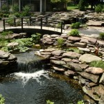Erney Landscaping rock walls and waterfall into large pond