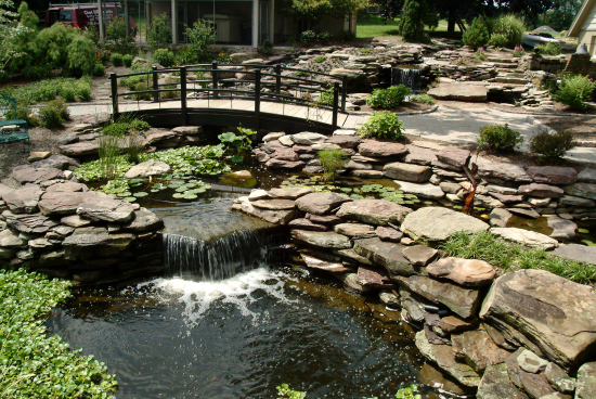 Genial Erney Landscaping Rock Walls And Waterfall Into Large Pond